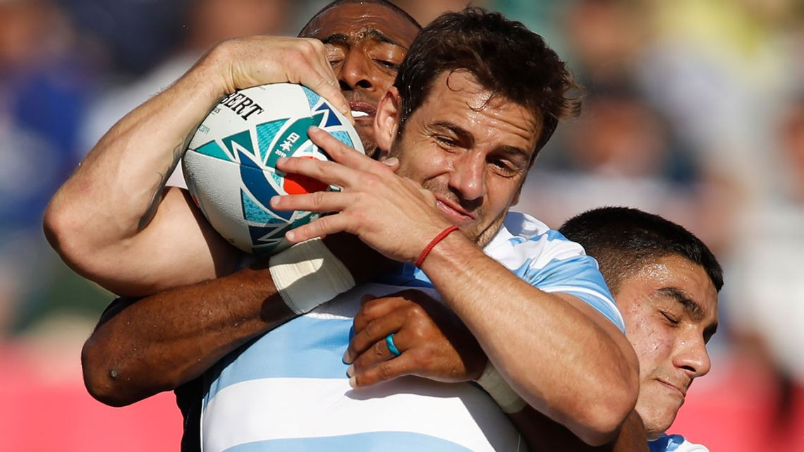 Pumas fly-half Nicolás Sánchez is tackled by US wing Marcel Brache during the Japan 2019 Rugby World Cup Pool C match between Argentina and the United States.