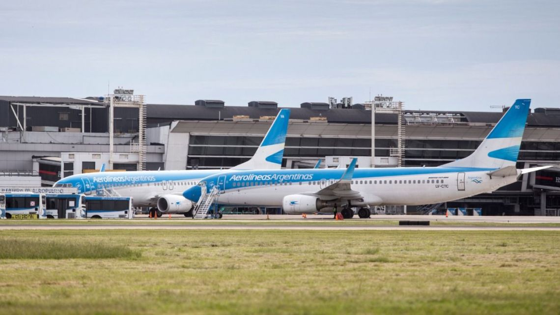 An Aerolíneas Argentinas plane waits on the tarmac before departure.