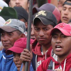 Anti-government protesters gather outside the Casa de la Cultura where indigenous protesters are based, in Quito, Ecuador.