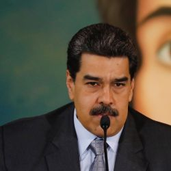 Backdropped by a painting of independence leader Simon Bolivar, Venezuela's President Nicolas Maduro gives a press conference at the Foreign Ministry in Caracas, Venezuela.