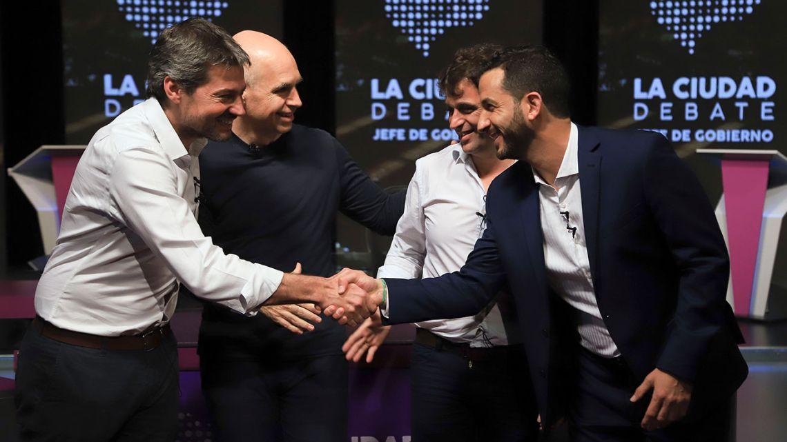 Candidates to become next Buenos Aires City mayor shake hands before Thursday night's debate: Matías Lammens (Frente de Todos), Horacio Rodríguez Larreta (Juntos por el Cambio), Gabriel Solano (Frente de Izquierda) and Matías Tombolini (Consenso Federal).