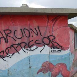 Street graffiti calls Provincial Governor Mariano Arcioni an