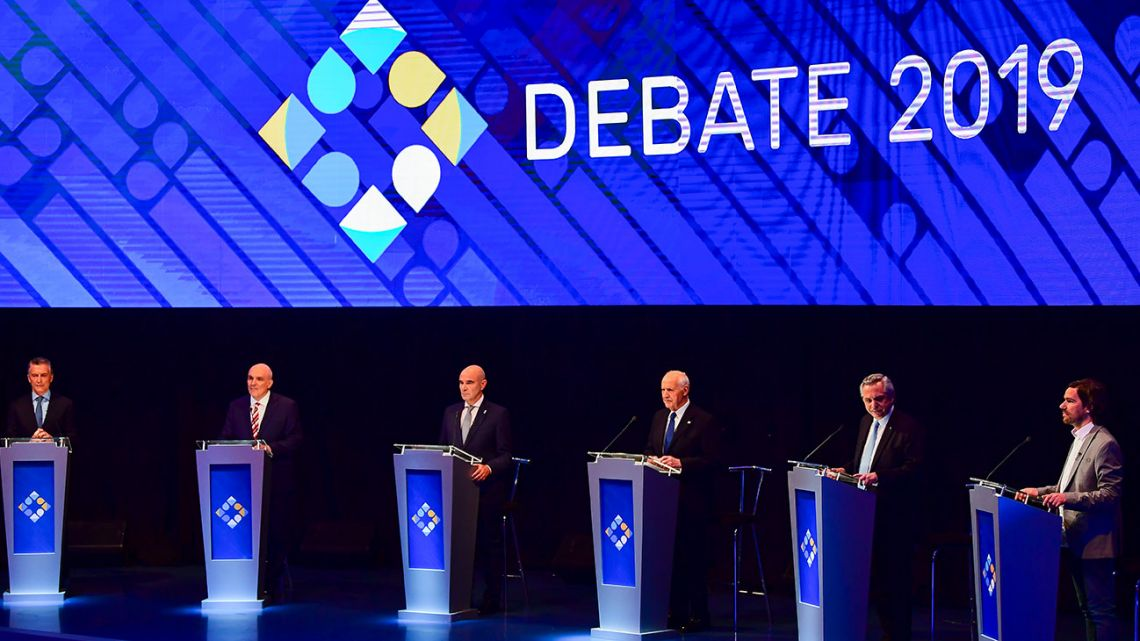 Argentina's six candidates – Mauricio Macri, José Luis Espert, Juan José Gómez Centurión, Roberto Lavagna, Alberto Fernández and Nicolás del Caño – take to the stage for the first presidential debate in Santa Fe, on October 13, 2019, ahead of the upcoming October 27 presidential election.
