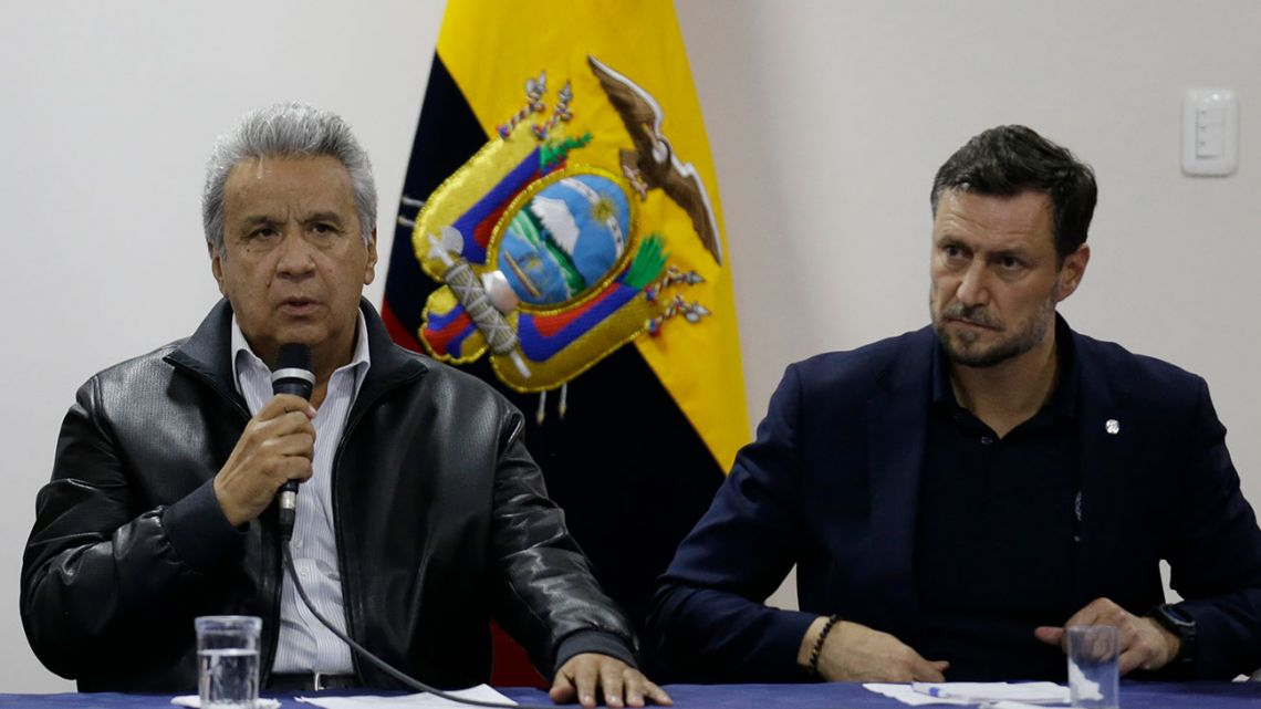 Ecuadorean President Lenín Moreno, left, speaks during negotiations with anti-government protesters as Arnaud Peral Resident Coordinator of the United Nations System and UNDP Representative in Ecuador, right, listen in Quito, Ecuador, Sunday, October 13, 2019