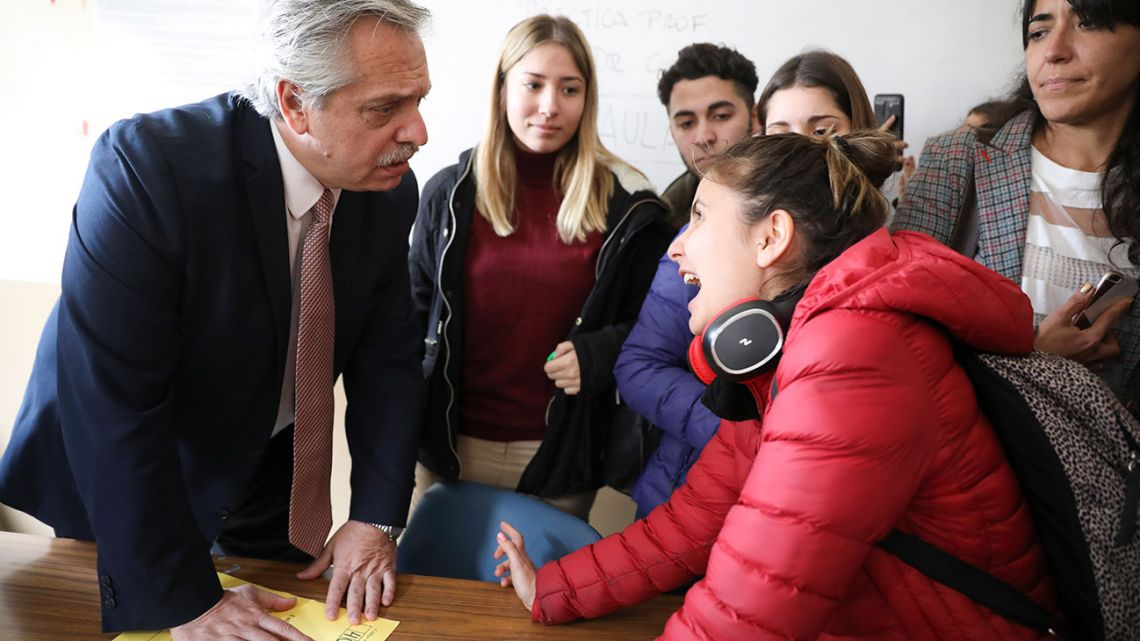 Presidential frontrunner Alberto Fernández listens to a student at the end of an oral exam in his classroom at the University of Buenos Aires School of Law on Wednesday.