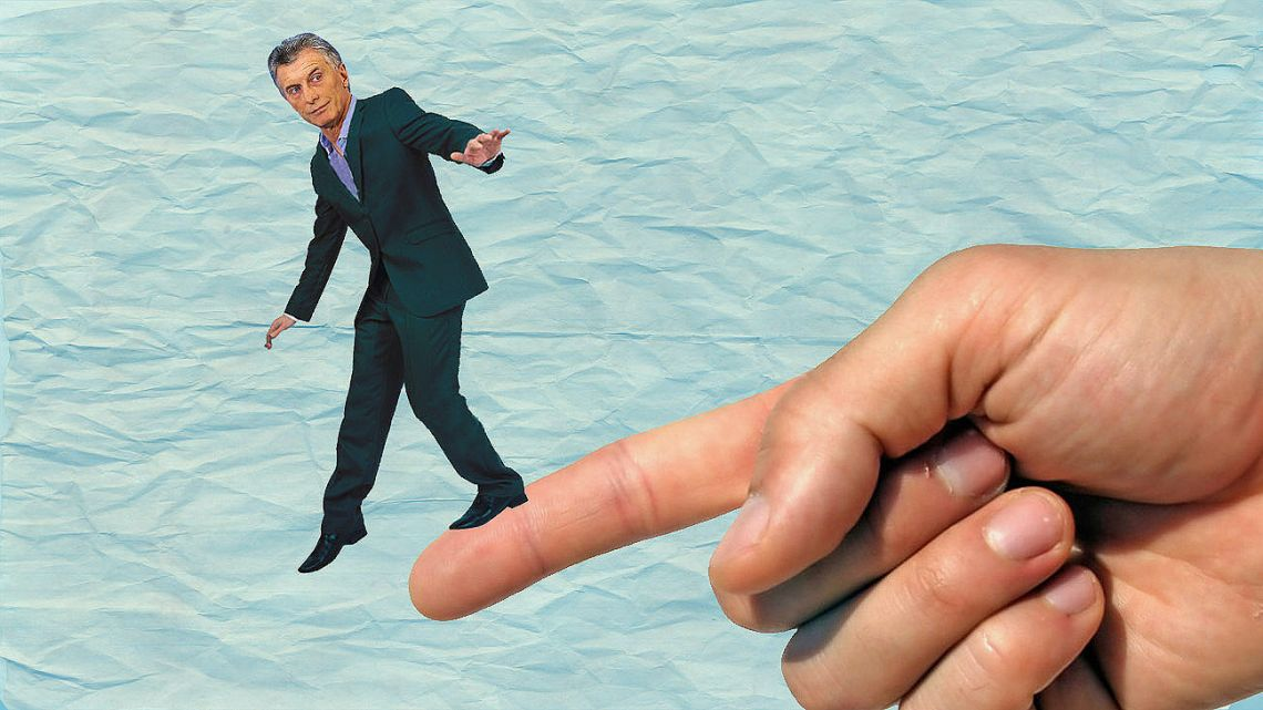 Macri questioned Alberto's use of his pointing finger.