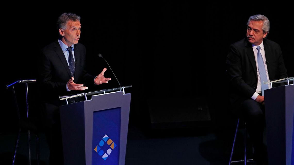 President Mauricio Macri, running for re-election with Juntos Por el Cambio, speaks during Sunday night's presidential debate, as rival Alberto Fernández, of Frente de Todos looks on.