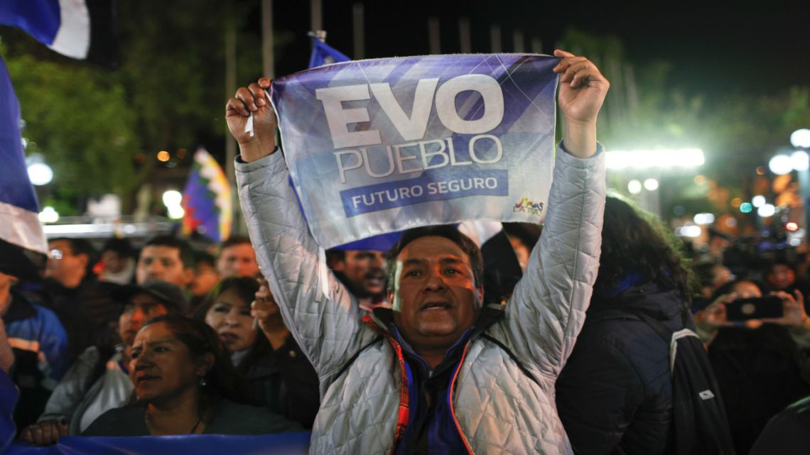 A supporter of Bolivian President Evo Morales shows his support outside the presidential palace in La Paz, Bolivia.