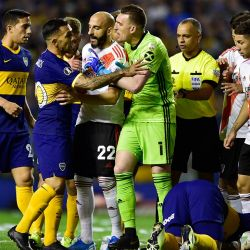 Goalkeeper Franco Armani of River Plate and Carlos Tevez of Boca Juniors argue as their teammates surround them, during a Copa Libertadores semi-final second leg at La Bombonera.