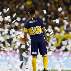 Carlos Tevez of Boca Juniors stands amidst flying paper, prior to the start of the Copa Libertadores semi-final second leg.