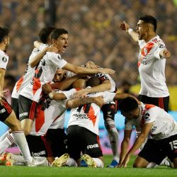 River Plate's players celebrate at the end of the Copa Libertadores semi-final second leg at La Bombonera.