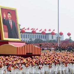 Desfile. Los festejos con la imagen del actual presidente de la República Popular China, Xi Jinping.   Foto:AFP