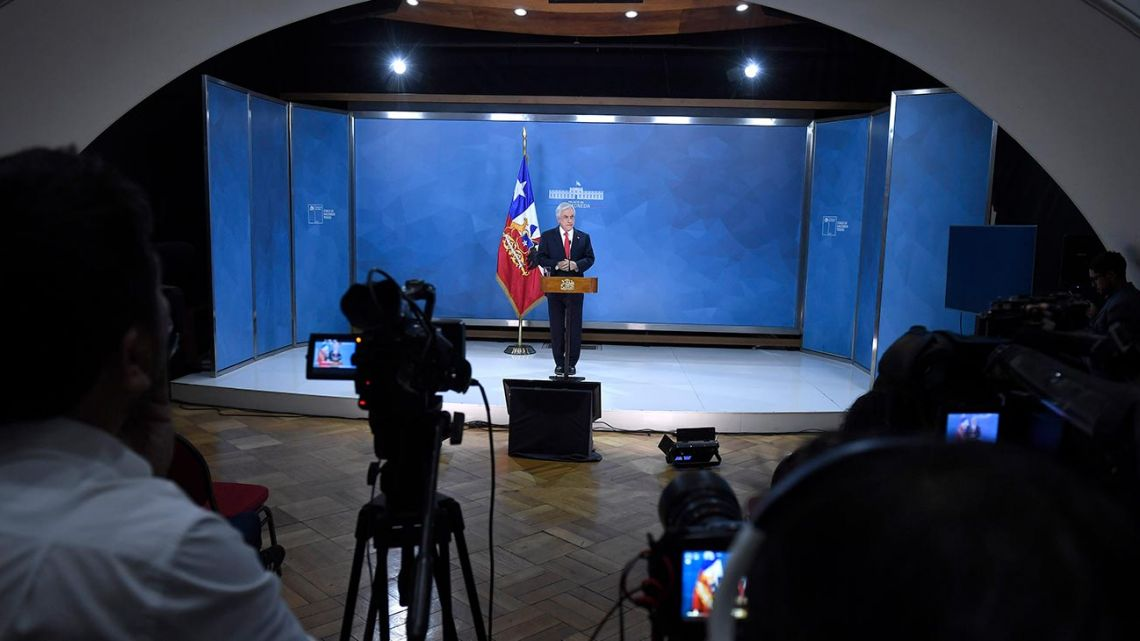 Handout picture released by the Chilean Presidency shows President Sebastián Piñera speaking to the nation from Santiago.