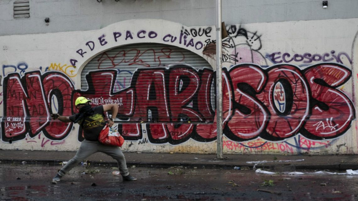 A demonstrator clashes with security forces in Santiago