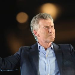 "Argentine President Mauricio Macri, who is running for reelection with the ""Juntos Por el Cambio"" party, acknowledges his supporters as he speaks during a campaign rally in Cordoba, Argentina."