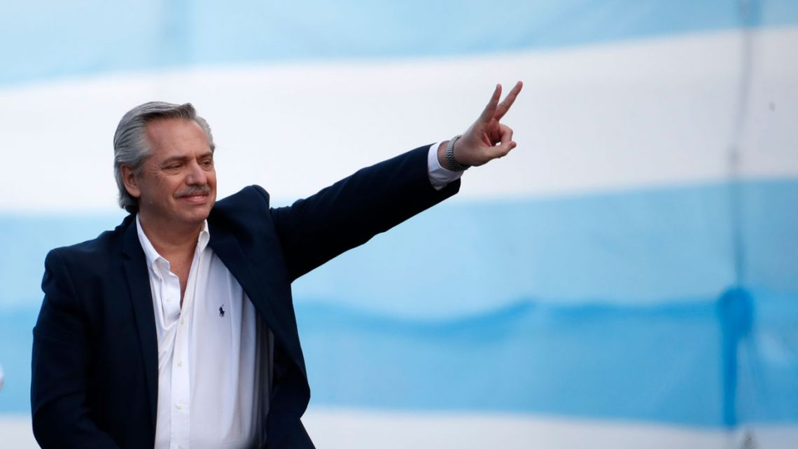 Presidential candidate Alberto Fernández makes the sign of victory to his supporters in the final campaign rally in Mar del Plata