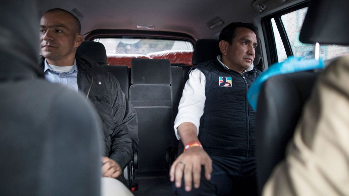 Wilson Florez, right, candidate for government of Cundinamarca of Democratic Center political party, in armored vehicle in Bogota.