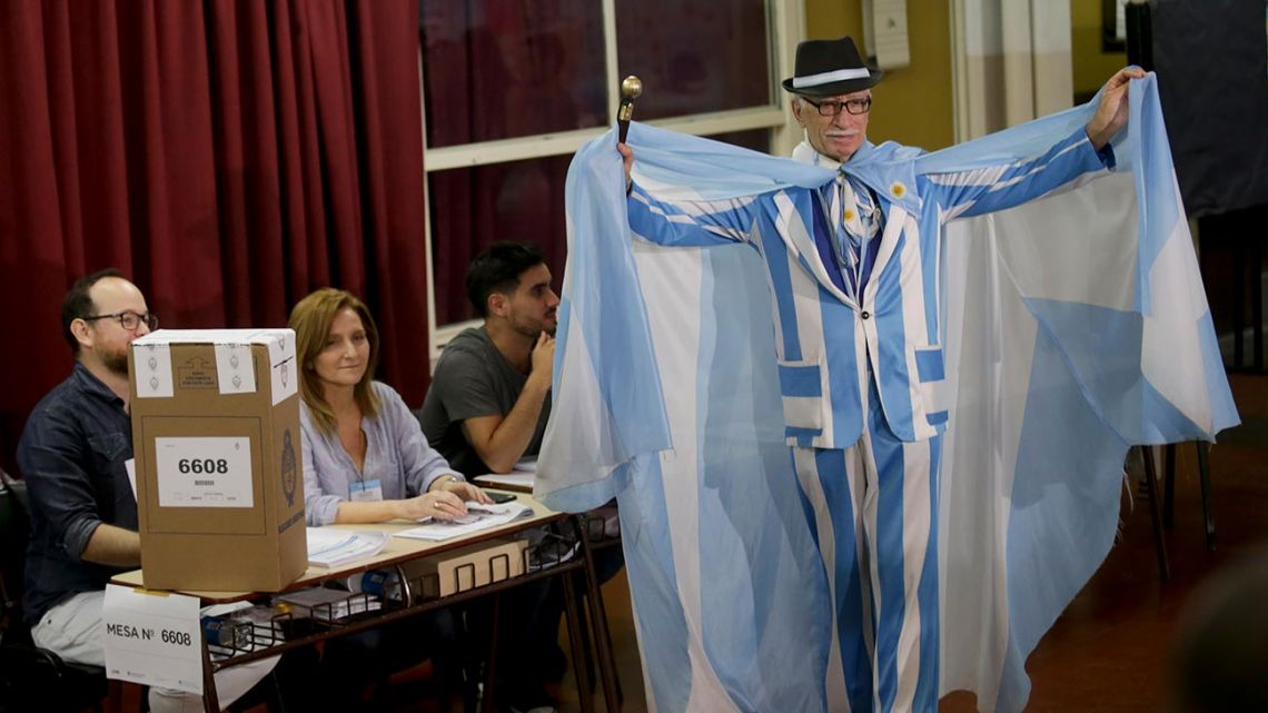 A man displays his Argentine outfit before voting Buenos Aires, Argentina, Sunday, Oct. 27, 2019.