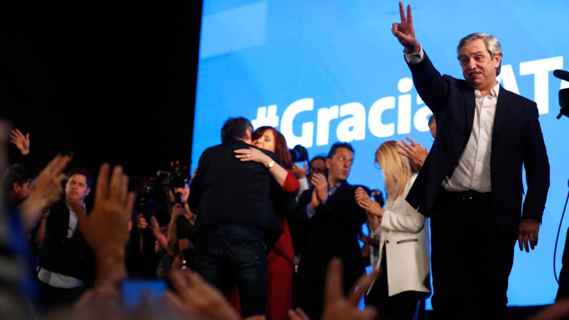 Peronist presidential candidate Alberto Fernández gestures to supporters after incumbent President Mauricio Macri conceded defeat.