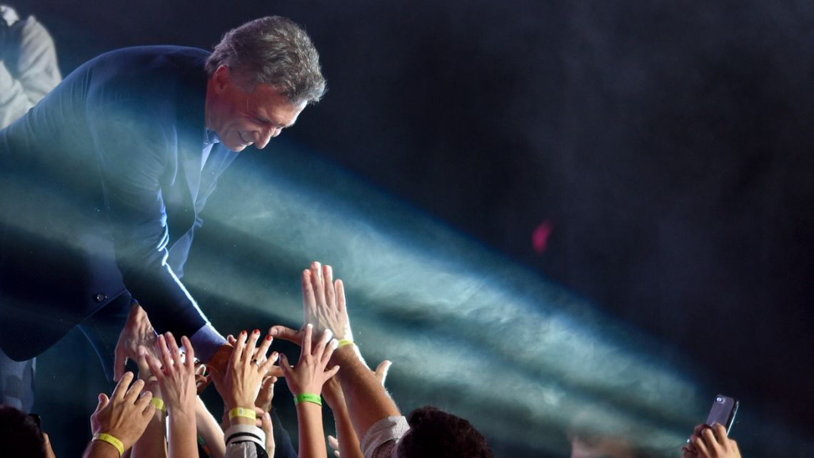 President Mauricio Macri greets supporters after he conceded defeat on Sunday night.