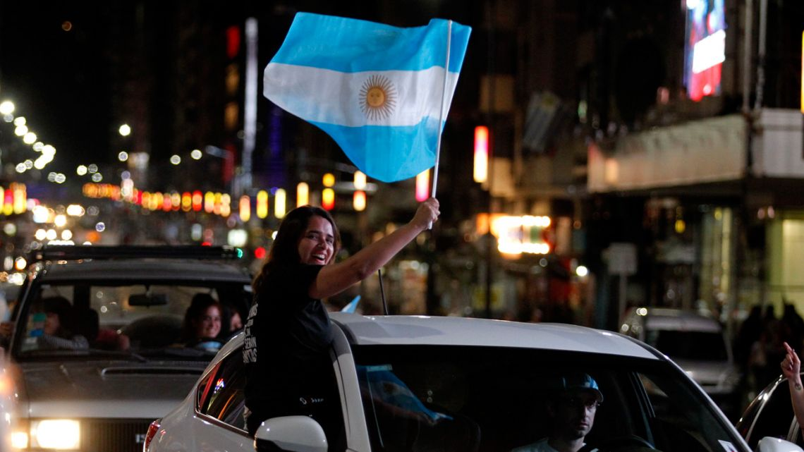 Supporters of Frente de Todos and Alberto Fernández celebrate his win in the general elections at the Obelisco in Buenos Aires.