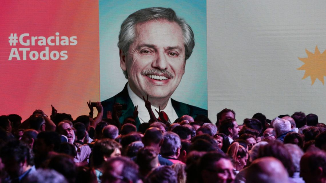 An image of president-elect Alberto Fernández is displayed at the party's headquarters during an election night rally in Chacarita.