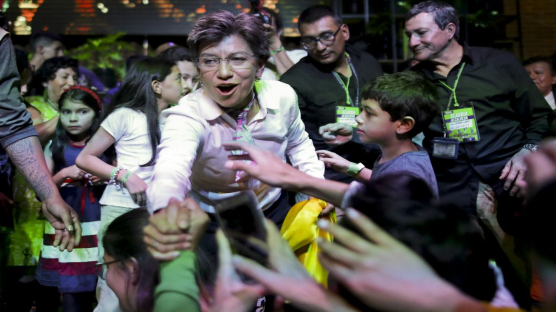 Claudia Lopez, candidate for mayor of Bogota with the Green Alliance, celebrates her election victory in Bogota, Colombia.