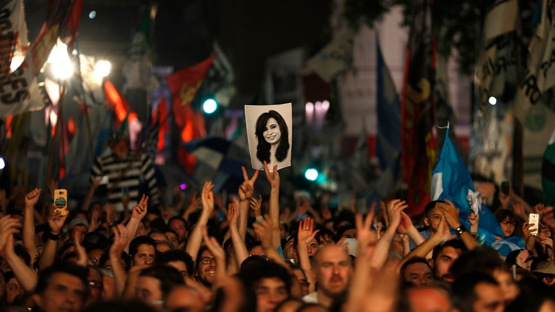Peronists celebrate after President Mauricio Macri conceded defeat at the end of election day in Buenos Aires on Sunday.