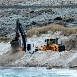 Zimbabwean citizens work on a mined beach in Stanley, Malvinas (Falkland) Islands.