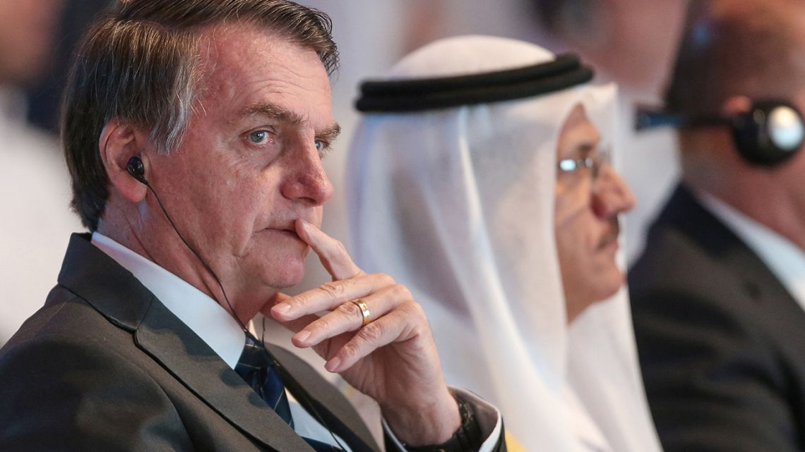 Brazilian President Jair Bolsonaro looks on as he attends the Brazil-United Arab Emirates Business Forum in the Emirati capital Abu Dhabi, on October 27, 2019.