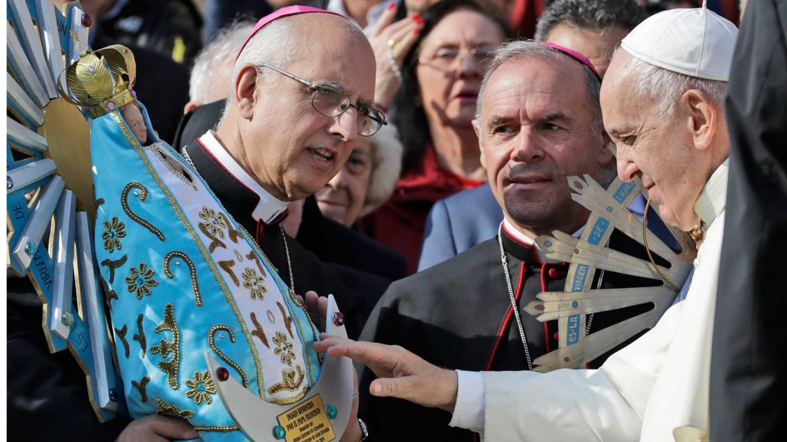Pope Francis blesses a replica of a statue of Our Lady of Luján, which was brought to Britain at the end of the Falklands War, as he meets with Bishop Santiago Olivera, left, and Bishop Paul Mason, centre, at the end of his weekly general audience in St. Peter's Square, at the Vatican, Wednesday, October 30, 2019. The original statue of the Virgin Mary, Patroness of Argentina, partially seen behind the pontiff, will be returned to Argentina and its replica, made in Argentina, will be donated to the Catholic Military Cathedral of St. Michael and St. George in Aldershot, Britain.