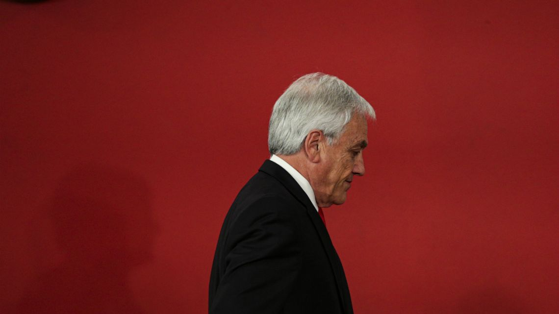 Chile's President Sebastian Piñera leaves after introducing his reshuffled Cabinet in Santiago, Chile