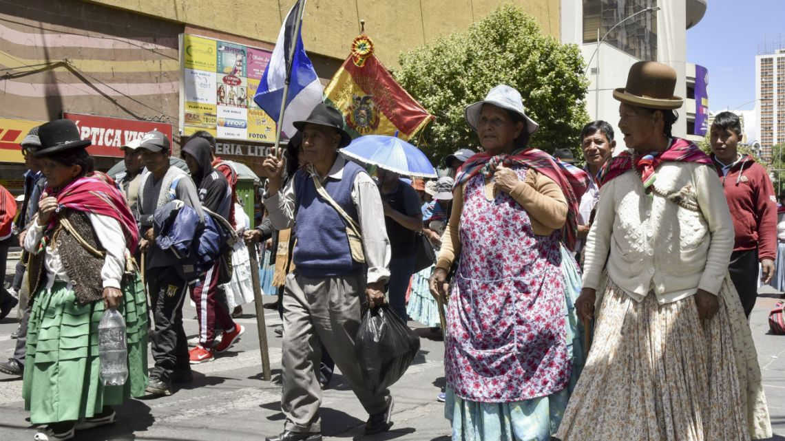 Supporters of the Movimiento Al Socialismo (MAS) party, march in La Paz on October 31, 2019, in support of Bolivian President Evo Morales.