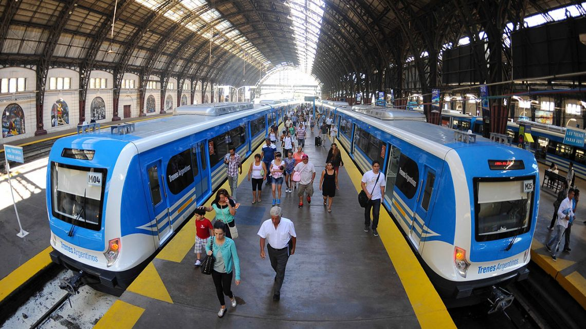 Passengers get off trains at Retiro station in Buenos Aires.