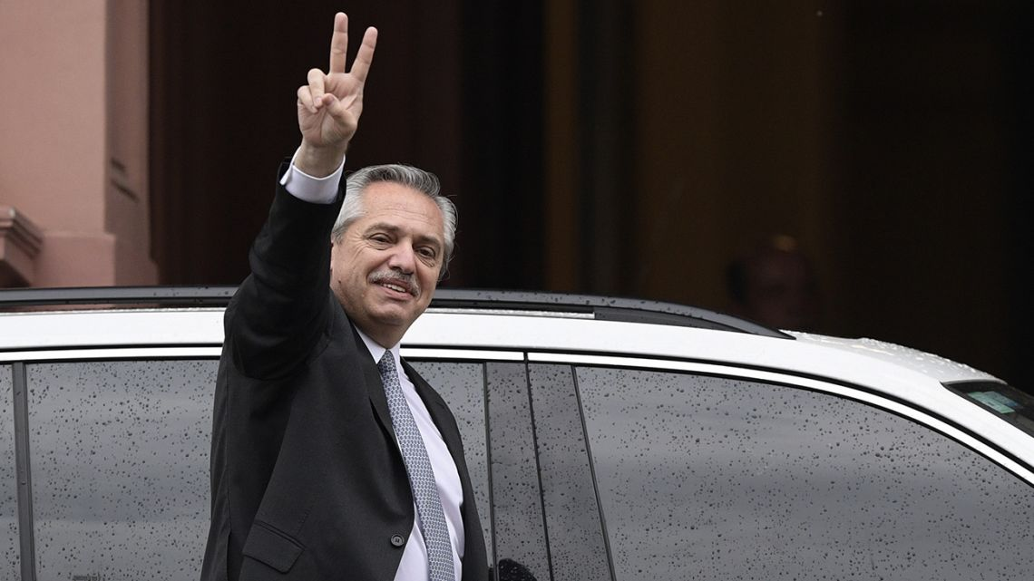 "President-elect Alberto Fernández flashes de ""V"" sign as he leaves the Casa Rosada presidential house."