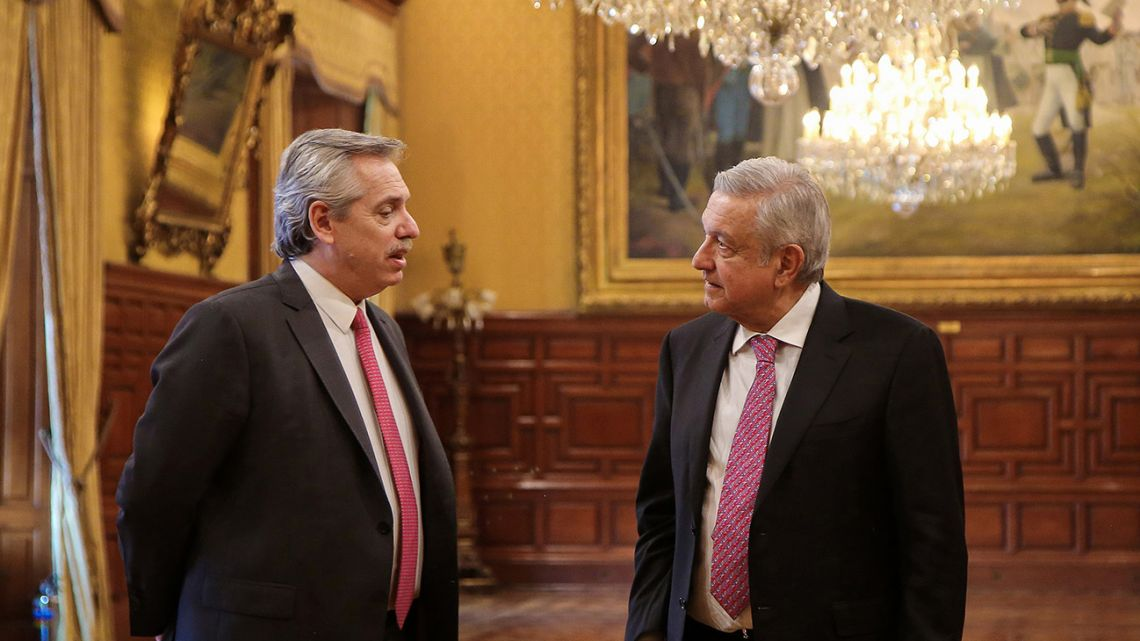 Handout picture released by the Mexican Presidency showing President-elect Alberto Fernández and Mexican President Andrés Manuel López Obrador talking during a meeting at the National Palace in Mexico City, on November 4, 2019.