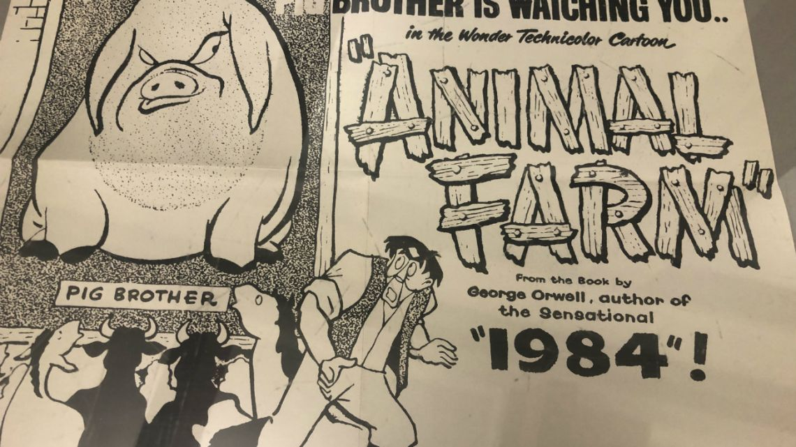 "A poster promoting a cartoon version George Orwell's novel ""Animal Farm"" is shown at an exhibit in Albuquerque, New Mexico celebrating the author's legacy."