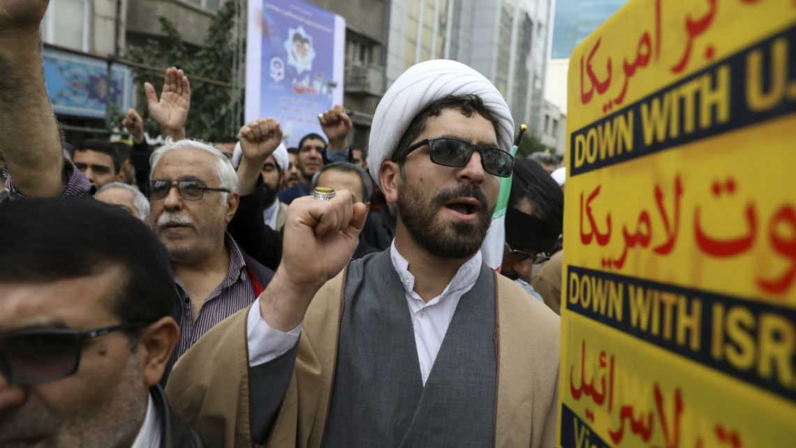 A Shiite Muslim cleric chants slogan during an anti-U.S. annual rally in front of the former U.S. Embassy in Tehran