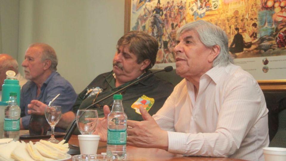 Plaini, Pignanelli y Moyano en la reunión del Frente Sindical
