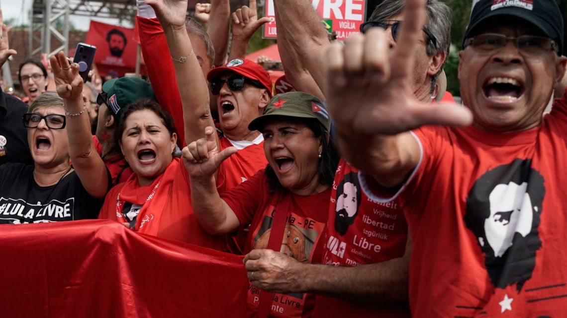 Supporters of Luiz Inácio Lula da Silva cheer the news.