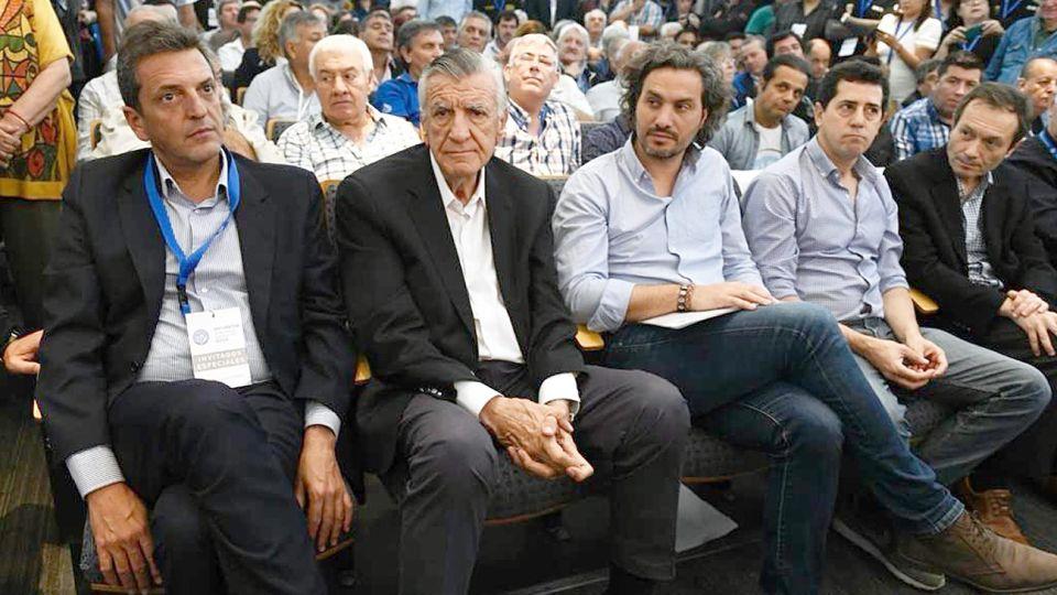 Primera fila. Estuvieron Massa y Gioja, junto a tres de los hombres gestores de la transición: Cafiero, De Pedro y Béliz.
