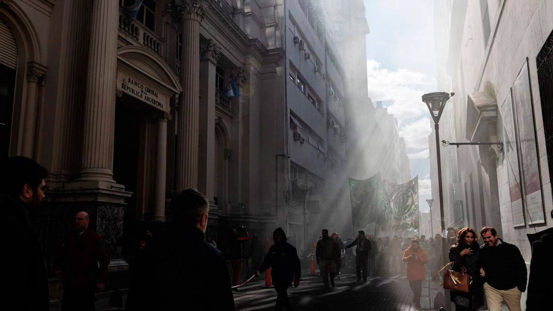 Demonstrators march past the Central bank in Buenos Aires.