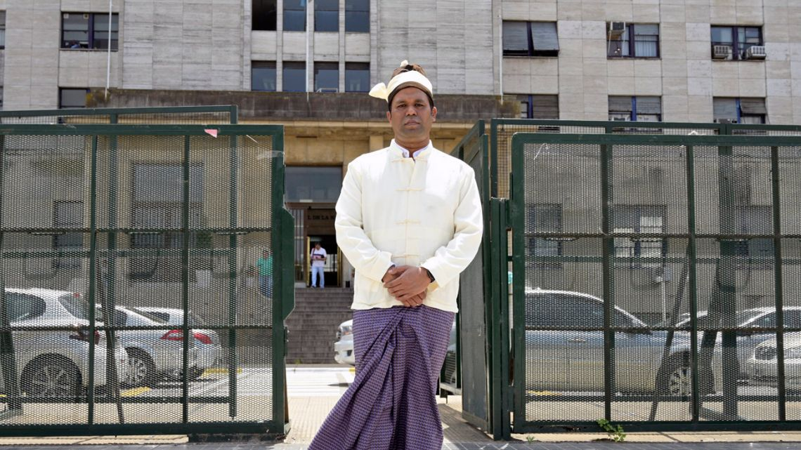 The president of the Burmese Rohingya Organisation UK (BROUK), Tun Khin, poses in front of a federal court in Buenos Aires.