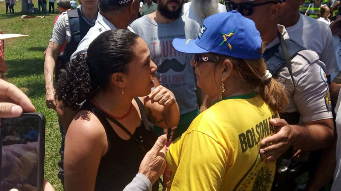 Pro-Guaidó and Maduro supporters argue in front of the Venezuelan embassy in Brasilia, Brazil, on November 13, 2019, while loyalists to Venezuelan opposition leader Juan Guaidó and President Nicolás Maduro faced off inside the country's embassy. Embassy officials opened the doors to Guaidó's appointed ambassador Teresa Belandria after recognizing the opposition leader as president, the envoy said in a statement.