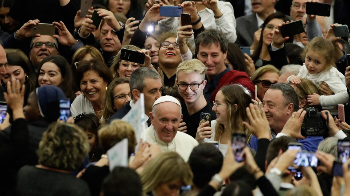 Pope Francis arrives in the Paul VI Hall at the Vatican for an audience with students and teachers of the LUMSA Catholic University, Thursday, Nov.ember 14, 2019.