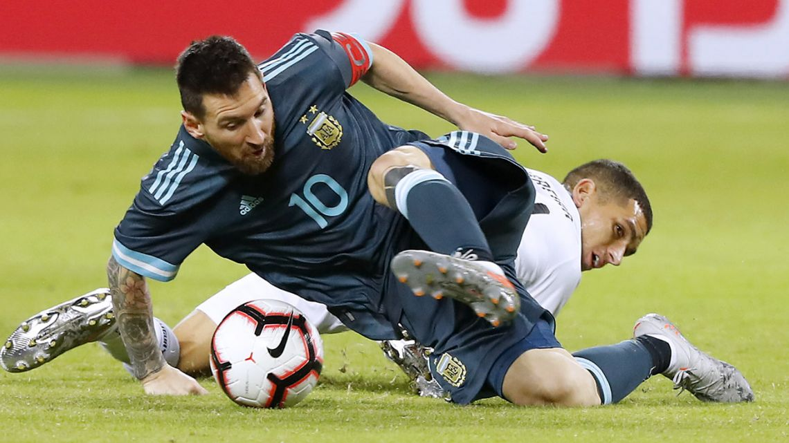 Lionel Messi fights for the ball with Uruguay midfielder Lucas Torreira during the friendly football match between Argentina and Uruguay at the Bloomfield stadium in the Israeli coastal city of Tel Aviv.