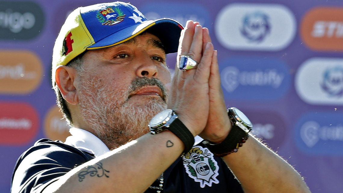 In this file photo taken November 2, 2019, Gimnasia y Esgrima coach Diego Armando Maradona gestures to supporters.