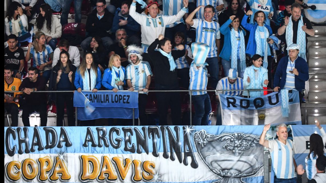 Argentina's supporters cheer during the singles tennis match between Argentina's Diego Schwartzman and Germany's Jan-Lennard Struff at the Davis Cup Madrid Finals 2019 in Madrid on November 20, 2019.