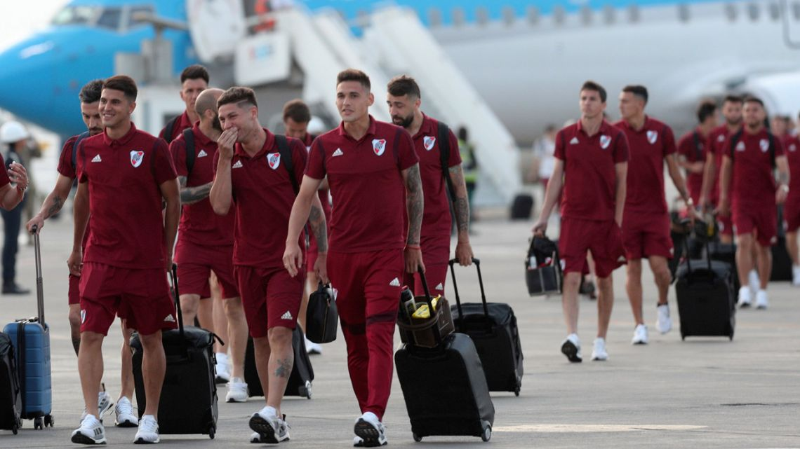 The River Plate squad walks on the tarmac after arriving to the military airport Grupo Aereo 8, in Lima, Peru, Wednesday, November 20, 2019.