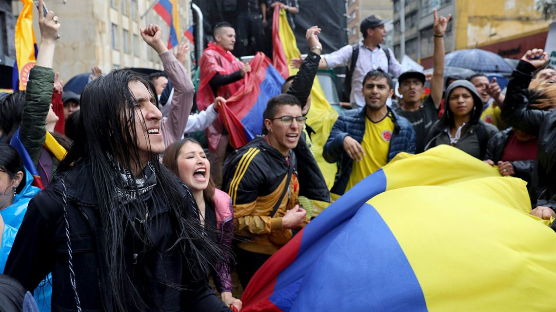 Students rally during a nationwide strike at Plaza Bolívar in downtown Bogotá, Colombia, Thursday, November 21, 2019.
